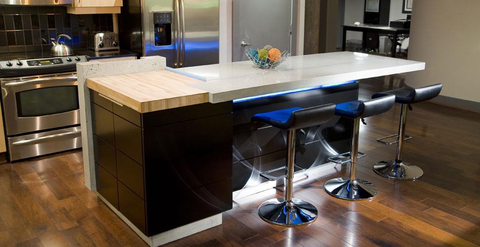 Concrete countertops and concrete kitchen island with under-lighting by Reaching Quiet Design | Concrete Exchange