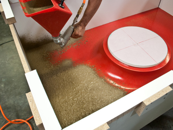 Spraying and Backing Step 2.1 - Fabric Formed Concrete Fire Table | CHENG Concrete Exchange
