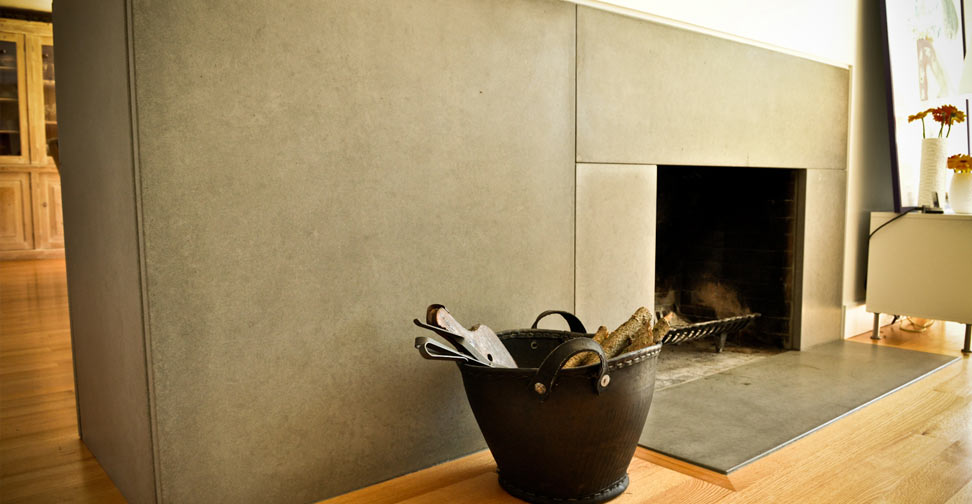 Wrap-Around Concrete Fireplace Surround and Hearth by Yves St. Hilaire | Concrete Exchange