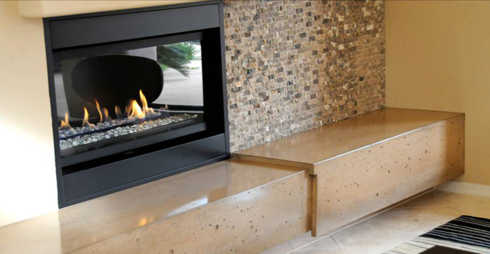 See pictures of an award-winning concrete fireplace hearth that has become the focal point of the room.