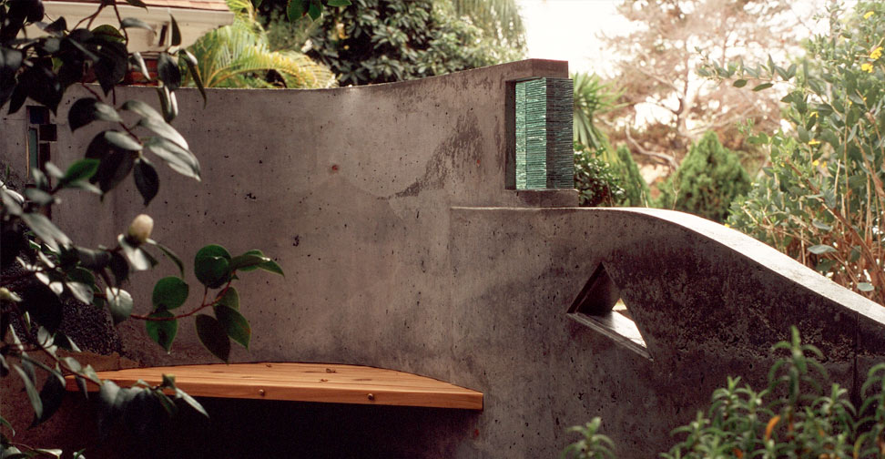 Concrete Wall with Glass Inlay and Wood Bench by Gary Day | Concrete Exchange
