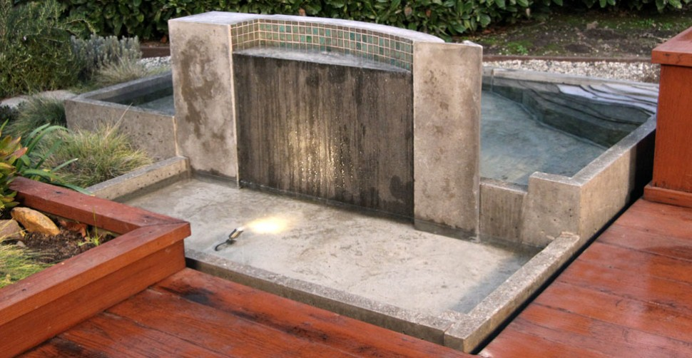 Concrete wall with water feature by The Ranch Design Group, Darron Endo |CHENG Concrete Exchange
