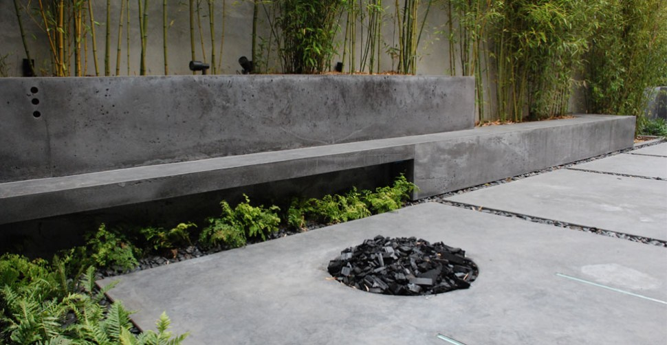 Outdoor concrete living area with concrete firepit | CHENG Concrete Exchange